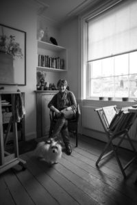 An image showing me sat in my studio with Maximus.